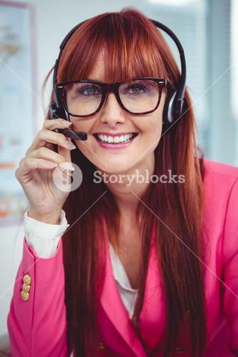 Smiling hipster businesswoman with headset