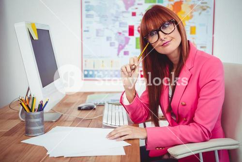 Smiling hipster businesswoman at her desk