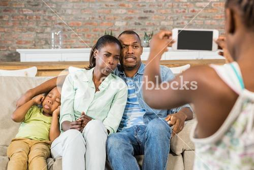 Happy family taking a picture on the couch