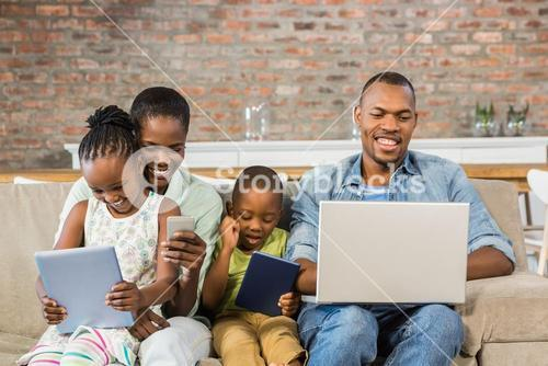 Happy family using technology together