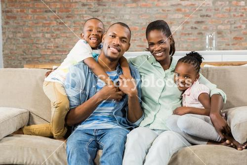 Happy family relaxing on the couch