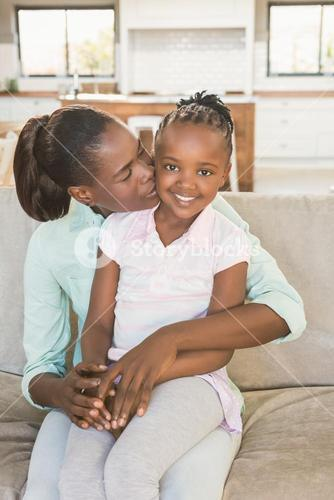 Loving mother with daughter on the couch