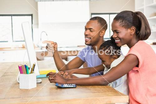 Smiling casual family on a computer