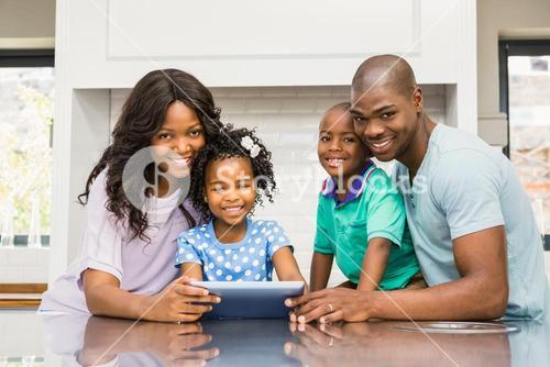 Happy family using tablet