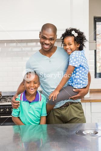 Father and kids in the kitchen