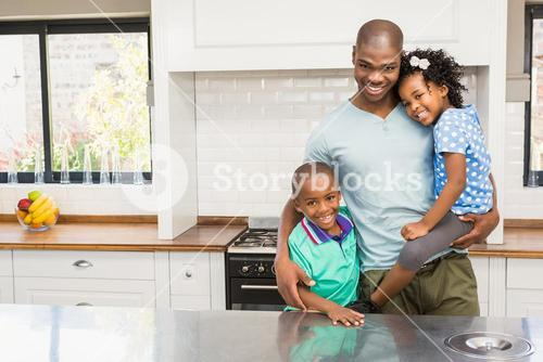 Father and children in the kitchen