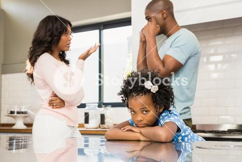 Parents arguing in front of daughter