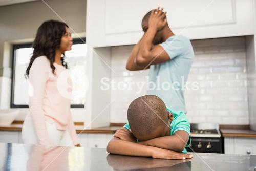 Mother and father arguing in the kitchen