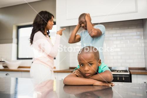 Parents arguing in front of son