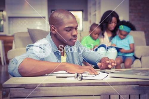 Man with bills and calculator