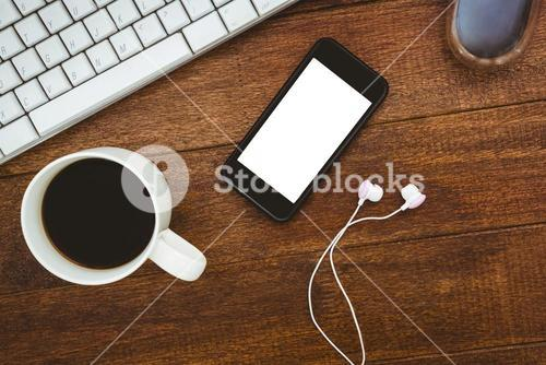 View of a mug of coffee and a smartphone