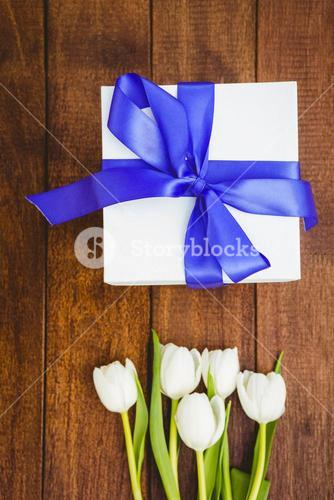 View of white flowers and blue gifts