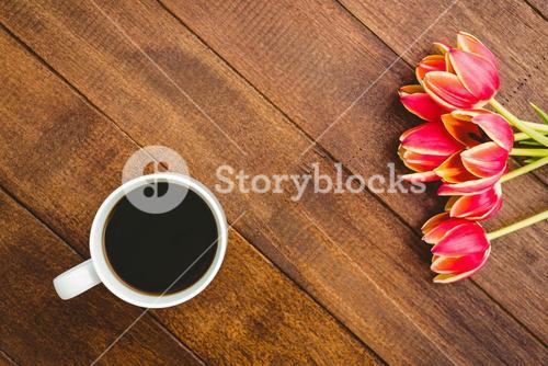 Red flowers and a cup of coffee
