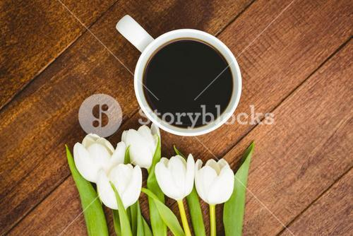 White flowers and a cup of coffee