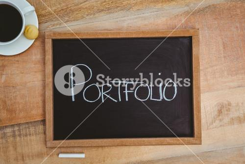 Portfolio against a big blackboard