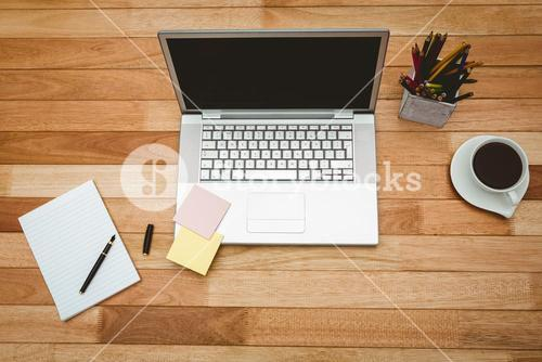 View of a grey laptop with coffee