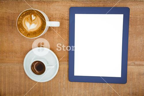 Above view of coffee and a blue tablet