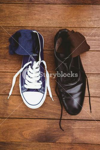 View of two different shoes