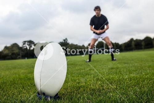 Rugby player about to kick ball