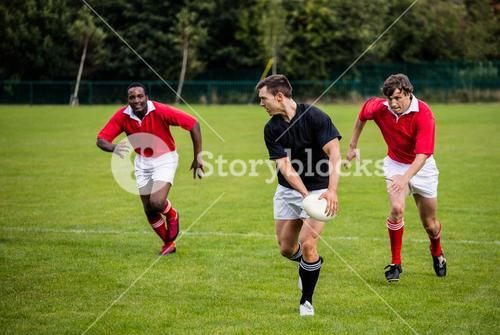 Rugby players running during game