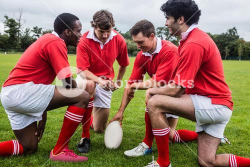 Rugby players discussing tactics before match