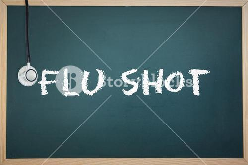 Flu shot against chalkboard