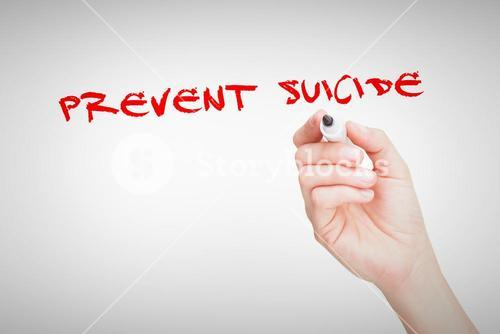 Prevent suicide against female hand holding black whiteboard marker