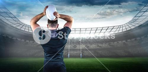 Composite image of tough rugby player throwing ball