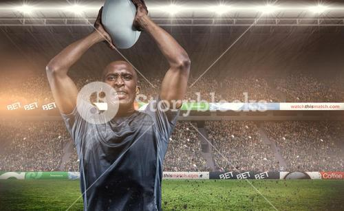 Composite image of determined sportsman throwing rugby ball