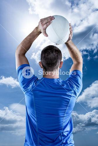 Composite image of rear view of rugby player throwing ball