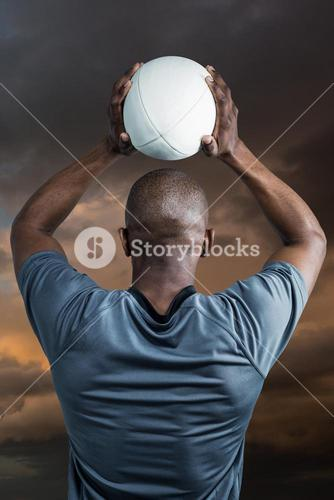 Composite image of rear view of athlete throwing rugby ball