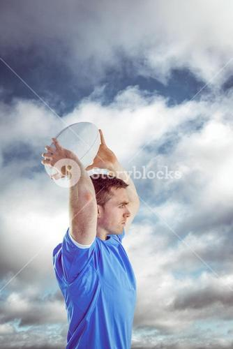 Composite image of disappointed rugby player holding his head