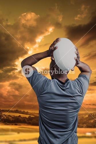 Composite image of rear view of sportsman throwing rugby ball