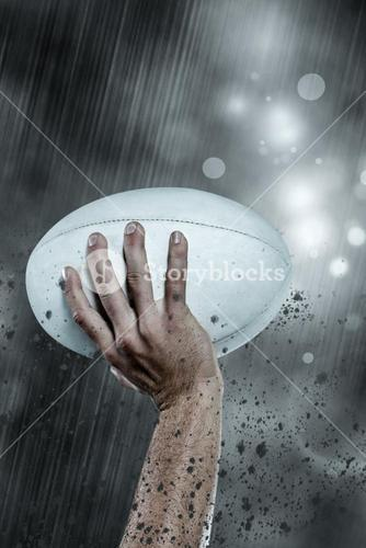 Composite image of cropped image of sports player holding ball