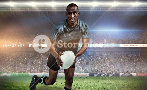 Composite image of portrait of determined sportsman running with rugby ball