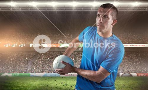 Composite image of rugby player looking away while holding ball
