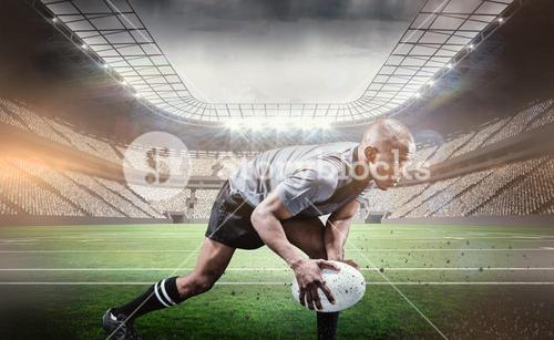 Composite image of determined athlete bending while playing rugby