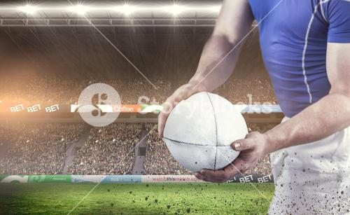 Composite image of rugby player about to throw the rugby ball
