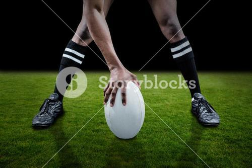 Composite image of low section of sportsman playing rugby