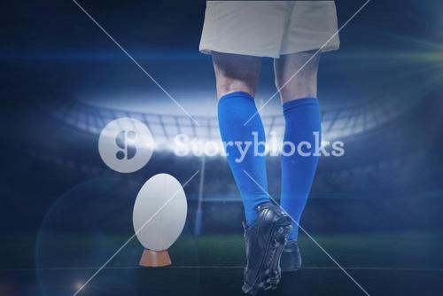 Composite image of low section of rugby player going to kick the ball