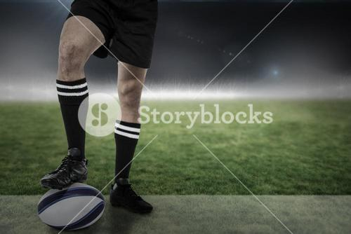 Composite image of sports player in black socks on ball