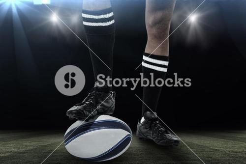 Composite image of rugby player in black socks on ball