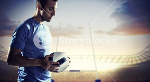 Composite image of thoughtful sports player holding ball