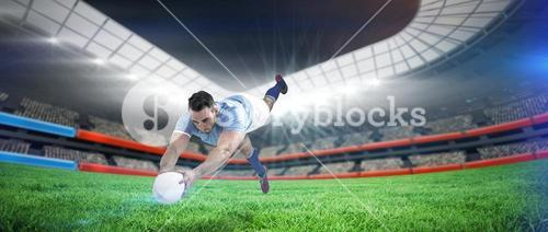 Composite image of rugby player scoring a try