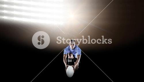 Composite image of portrait of rugby player kneeling and holding ball
