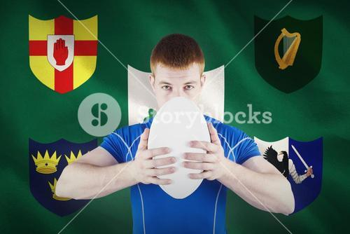 Composite image of rugby player holding rugby ball
