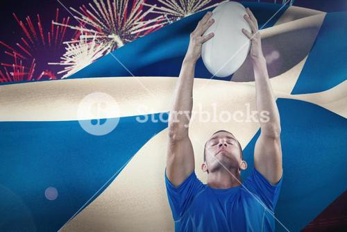 Composite image of rugby player holding ball with eyes closed