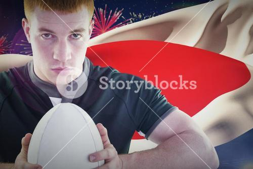 Composite image of rugby player holding a rugby ball
