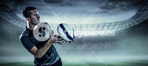 Composite image of sports player catching the ball