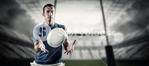 Composite image of rugby player trying to catch the ball